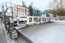 Wirtgen propose la SP 1500 4 chenille pour la pose bicouche de béton